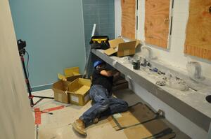 A piping Industry plumber works to complete the plumbing inside of the new Dave and Buster's in Toledo.