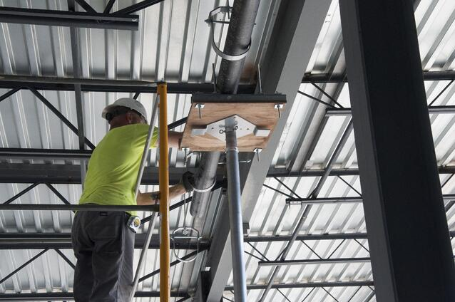 A Piping Industry pipefitter works at the new Defiance Senior and Junior High School.
