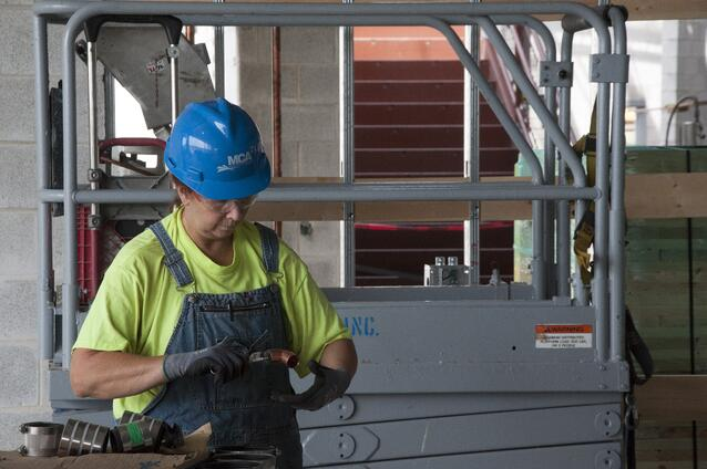 A Piping Industry member installs a copper water pipe in the new Defiance Senior and Junior High School.